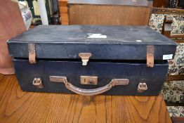 A vintage travel case having leather handle and straps, bearing part label