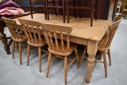 A traditional pine kitchen table and four similar solid seat chairs, table dimensions approx. 183
