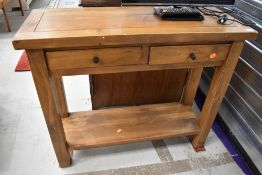 A modern hardwood side table having two frieze drawers, width approx. 91cm