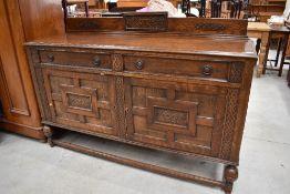 An early 20th Century oak sideboard, width approx. 153cm