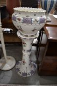 A late 19th/early 20th Century ceramic jardiniere and stand, unfortunately cracked throughout