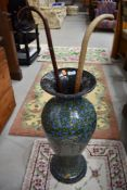A vintage papier mache stick stand of vase form, height approx. 67cm and two sticks