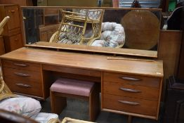 A vintage G plan or similar dressing table with stool, width approx. 170cm