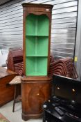 A reproduction Regency style mahogany corner display with open shelves over cupboard, height approx.