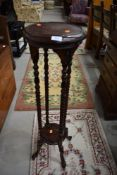 A reproduction stained frame plant stand, height approx. 103cm