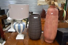 Two modern vases, and a similar lamp