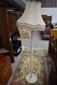 A traditional painted standard lamp and shade