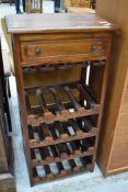 A modern hardwood wine rack (16 bottles) with frieze drawer