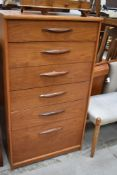 A vintage G plan or similar six drawer chest having extra deep bottom drawer, dimensions approx. W64