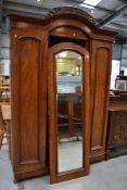 A Victorian mahogany wardrobe having central mirror door, width approx 143cm