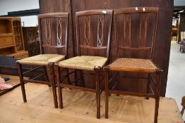 Three matching Edwardian mahogany and inlaid bedroom chairs, probably Maple & Co, with a variety