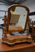A Victorian toilet mirror on drawer base, light stain, some historical worm been treated
