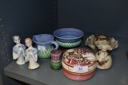 A variety of ceramics including two vintage half dolls, A Lancaster pottery trinket pot, and some