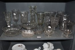a large lot of vintage glass vases and similar.