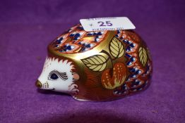 A Royal Crown Derby paperweight Orchard Hedgehog with gold stopper
