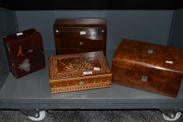 An assortment of boxes including walnut veneered with mother of pearl inlay, etched examples and