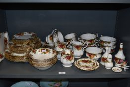 A selection of Royal Albert country roses, including plates,bowls,preserve pot, cups and saucers and