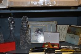 Two Waterford crystal decanters and similar Webb Corbett, also a selection of vintage place mats and