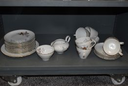 A collection of vintage plates ,cups and saucers , sugar basin and jug having transfer print of