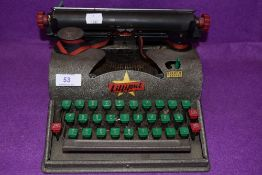 A vintage Lilliput Typewriter.