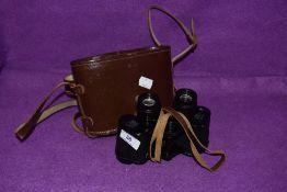 A pair of vintage Krauss binoculars and case.