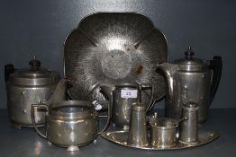 An interesting collection of vintage pewter ware including Tudor rose shaped dish,cruet set, tea/