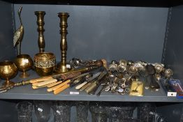 A collection of vintage brass and flat ware including souvenir spoons, sugar sifting spoons and