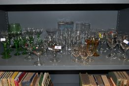 A collection of vintage glasses, various styles and colours.