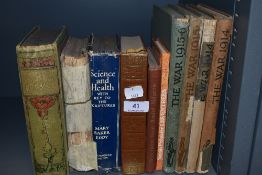 An assortment of vintage books including WW1 interest.