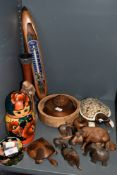 A selection of treen including matryoshka dolls, bowls and former mill shuttle/bobbin thermometer.