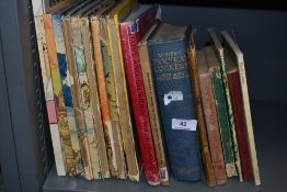 An assortment of vintage books including cookery and Rupert bear.