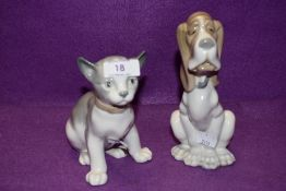 A pair of Lladro Nao figurines, Seated Dog and Cat