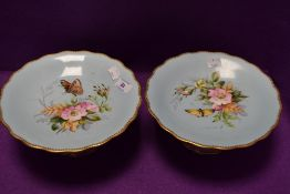 Two vintage cake stands having duck egg blue ground,gilt edging and hand painted dog rose and fern