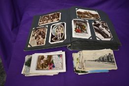 A collection of Postcards in album and loose including Street Scenes, Greeting Cards, Vintage,