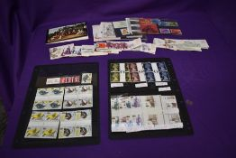 A collection of GB Stamps including High Value Blocks of Four, Presentation Packs and Stamp