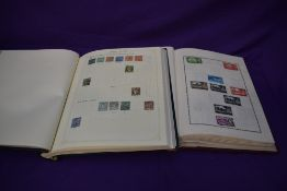Two partly filed albums of World Stamps including GB 1960's-1970's, Egypt, French Colonies,