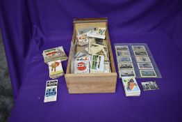 A box of Trade Cards and Cigarette Cards including Allen's Cure Em Quick, Nav's, A & BC, Flags of