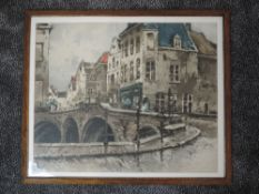A print, A street in Flanders, 45 x 55cm, framed and glazed
