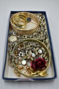 A small selection of plated jewellery including bangles, scarf ring, Scandinavian pins, Ingersoll