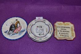 A selection of Italian ceramics including motto monogrammed dishes