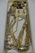 A selection of costume jewellery including necklaces, pendants, cufflinks, etc