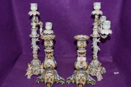 Two vintage ceramic candle sticks having cherubs to base and floral decoration AF, also included are