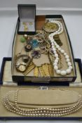 A selection of modern and vintage costume jewellery including triple string of simulated pearls, hat