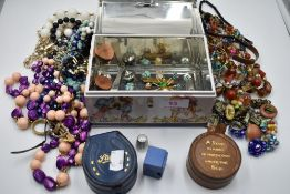 A Bluebird confectionery tin modelled as a chest containing a selection of costume jewellery