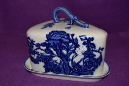 A ceramic cheese dome by Blakeney with blue and white transfer design base and cover both good