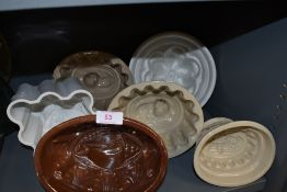 A selection of ceramic and earthen ware jelly moulds all in good condition