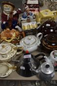 An assortment of quirky vintage and retro tea pots,jugs and similar, including