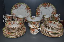 An antique part tea service by Sutherland china having green and red colour way