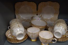 a part tea service by Tuscan china with a pink and gilt design