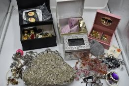 A selection of costume jewellery including earrings, pins, evening bag etc